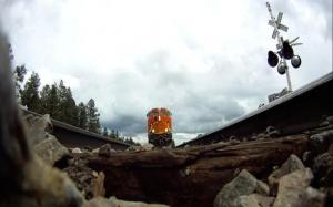 This video captures footage from under a train passing by at 75 mph, using a GoPro camera