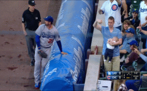 Fan makes amazing catch of foul ball while holding baby.