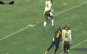 Western Michigan cornerback Asantay Brown is forced to leave the football field after being stunned by a sneaky hit.
