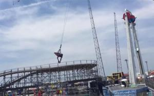 A Harlem Globetrotter makes an incredible trick shot while taking a 110 ft drop on the 'Sky Coaster' in New Jersey.